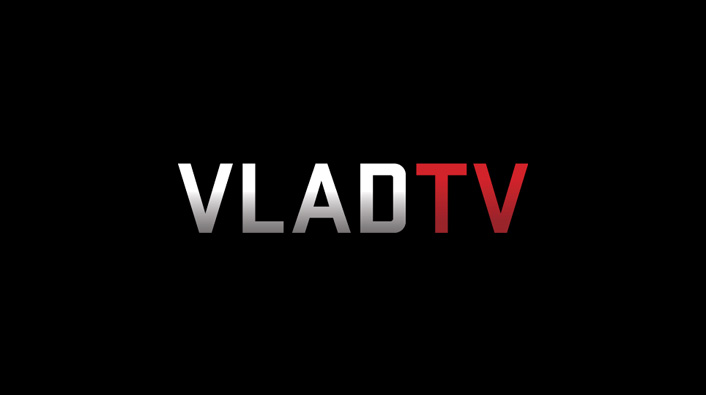 Image: Amber Rose Transforms Trademark Shaved Head with Red Wig