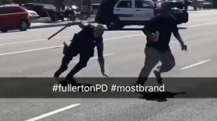 Image: Cop Falls to the Ground After Getting Juked by Fleeing Suspect