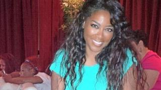 Kenya Moore Takes a Tumble on Las Vegas Runway