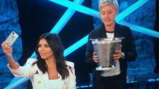 Kim Kardashian Takes Ice Bucket Challenge While Snapping Selfies