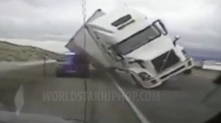 Wind Tips 18-Wheeler Truck onto Police Car in Wyoming